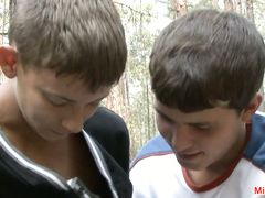 Elated teen boys Rabelaisian strolling