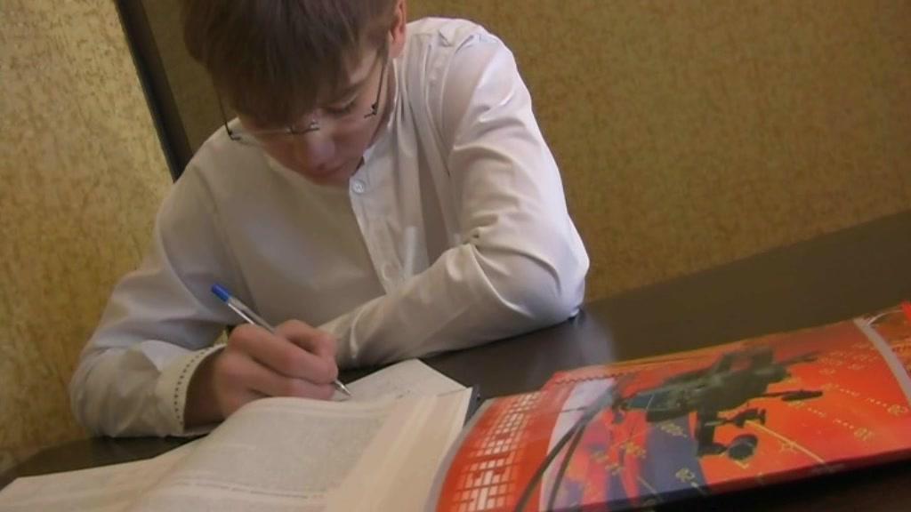 Ash-Blonde teenage doing homework